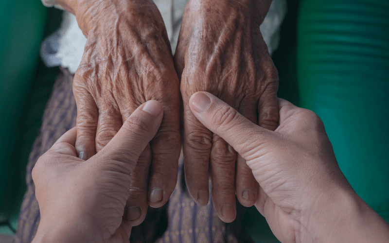 elderly woman hands - whole of life insurance