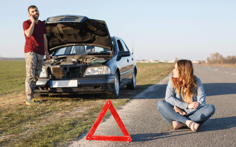 Car broken on the side of the road - car insurance